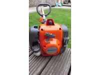 Bargain husqvarna petrol strimmer in as new condition