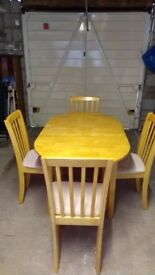 Small extending dining table with 4 chairs