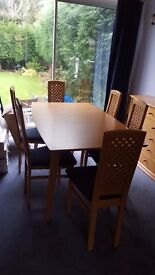 dining table, 8 chairs, unit, display cabinet and nest of tables.