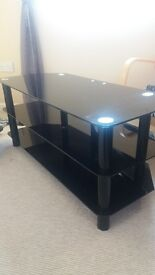t.v unit. black glass. wouldb suit 42' t.v. perfect condition