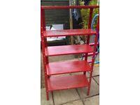 Red metal shelving