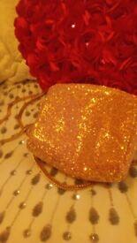 Rose gold glittery evening bag