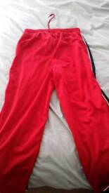 Mens size small red puma jogging bottoms