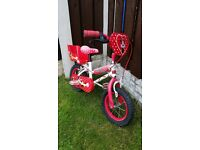 """Girls 12.5 """" bike minnie mouse with dolly seat can deliver for a small charge"""