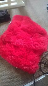 2x red fluffy cushion covers