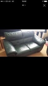 Bottle green leather sofa