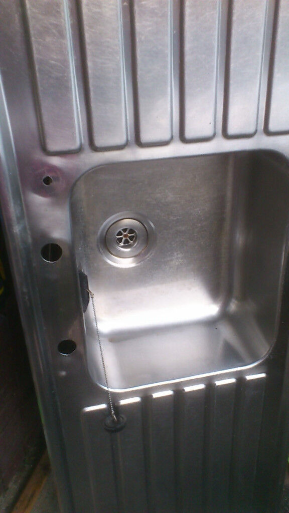 Stainless steel kitchen sink with double drainer.
