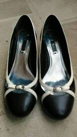 Size 4.5 NEXT low heel pumps/shoes in black and white