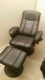 Black faux leather recliner and foot stool