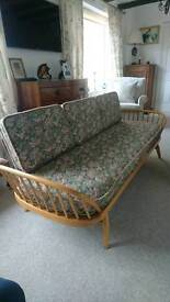 An Ercol daybed in excellent condition throughout