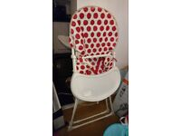 Red and white highchair