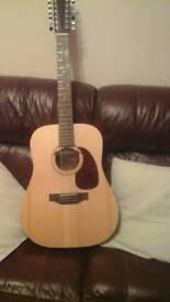 Sigma 12 string electro acoustic guitar