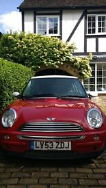 Mini cooper auto 2003. Red with white roof and white wing mirrors.