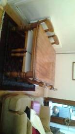 Oak dining room table with four chairs