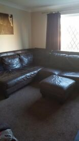 Brown leather corner suite.