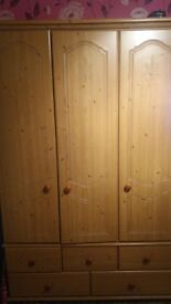 A wooden 3 door and 5 drawer wardrobe in good condition. 4foot wide and 6foot high.