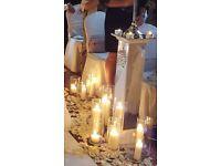 Beautiful mirrored Wedding pillars/ pedestals & 150 mostly snap dragon cylinder vases