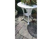 Heavy round white metal patio table