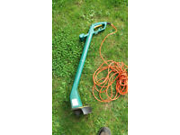Electric Strimmer with long cable.