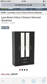 Black 4 door mirrored wardrobe 3 mths old