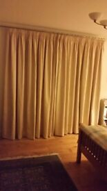 2 pairs of cream curtains with tan motif