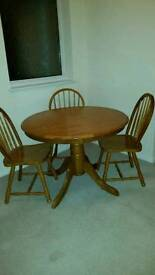 Oak table and three chairs