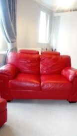 Red Leather two seater sofa and matching leg rest