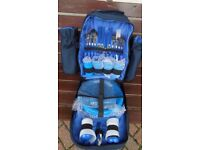 This is a four place picnic set in a dark blue rucksack new unused just £10