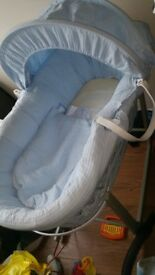 Grey and blue wicker moses basket