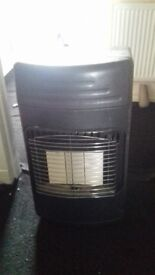 Gas fire very good condition comes with empty gas bottle