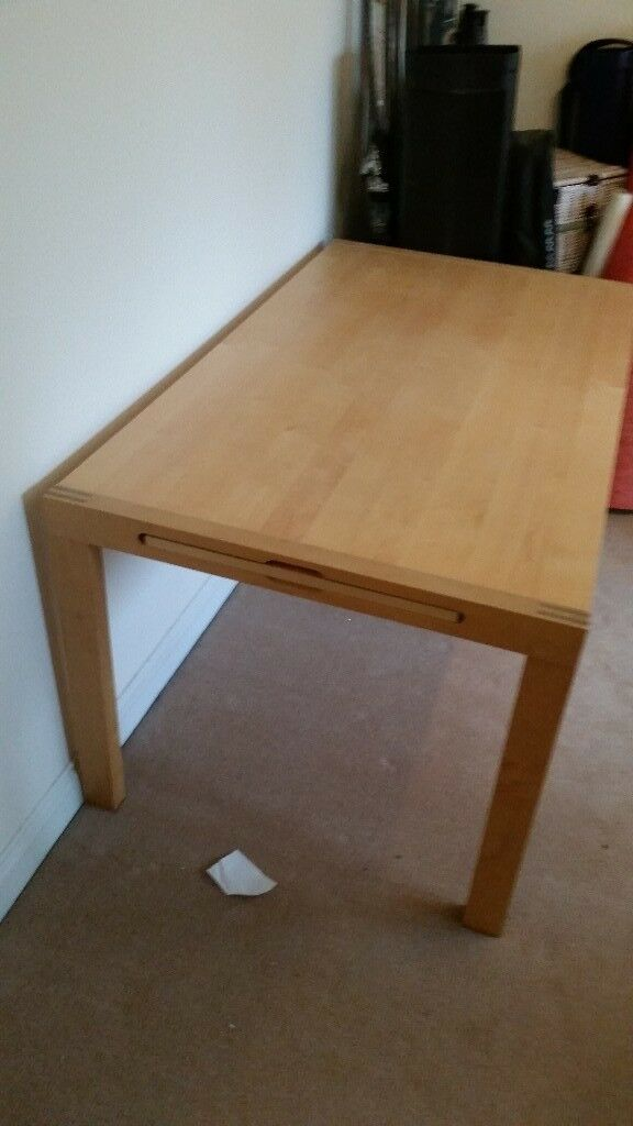 Ikea-style extendable beech veneer dining table and four matching chairs, all in good condition