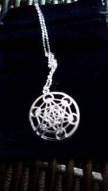 sacred geometry circular pendant on silver chain New