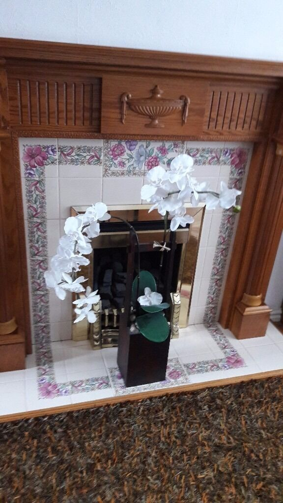 Fireplace ornamentin Derby, DerbyshireGumtree - Fireplace ornament with orchid flowers and little pebbles in a wooden type box .Collection only cash only