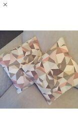 Three brand new geometric print cushions