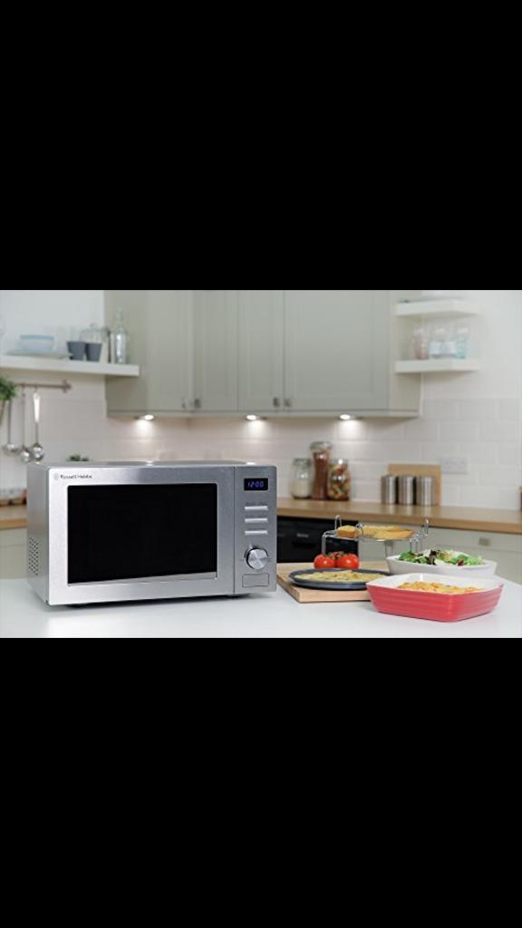 New in box Russell Hobbs RHM3202cg microwave still in Steel only £100 price