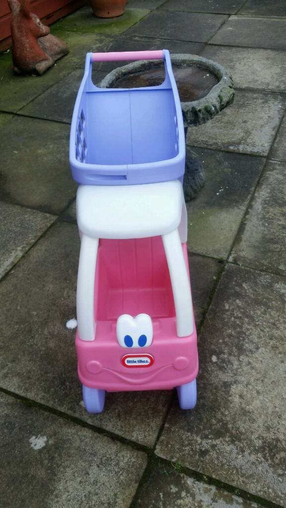Kids little tike shopping trolly and seat for dolls new never been out side