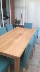 Immaculate Table and 8 chairs for quick sale