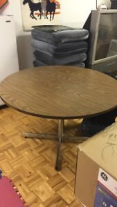 Vintage Round brown table with stainless steel legs