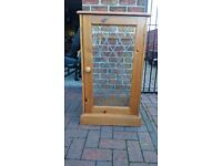 Pine Hi fi unit with leaded glass front door. Or display unit
