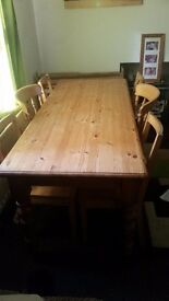 light pine wood dining table with six chairs. 2 master chairs. good condition