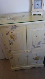 painted in Laura Ashley yellow with appliqued flowers and leaves - very pretty for a bedroom