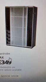Double wardrobe with glass sliding doors