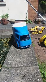 LITTLE TIKES ARTICULATED TRUCK SPLITS INTO TRACTOR UNOT AND TRAILER TRAILER HAS I SLIDING & 2 DOORS