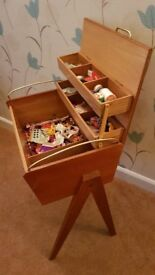 Vintage wooden sewing box, table including contents.