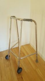 Wheeled walking frame (Zimmer) adjustable height