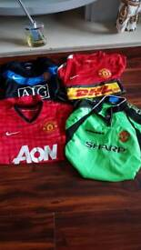 Four Manchester United shirts