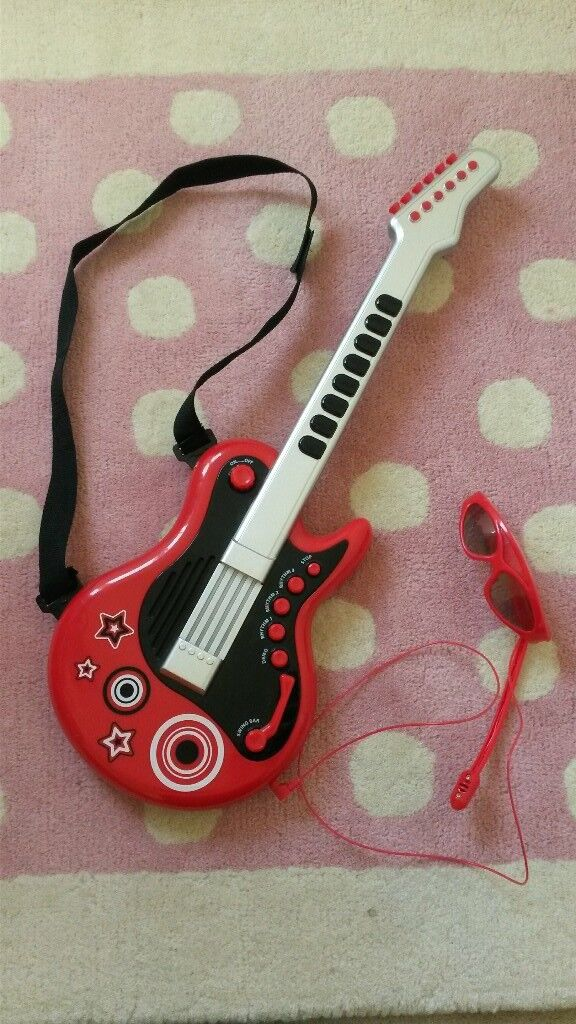 ELC guitar with shades and microphone £5