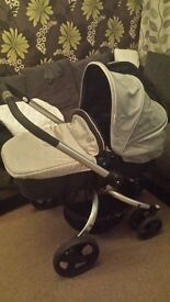 mothercare spin comes with rain cover, footmuff, top cover & padded liner