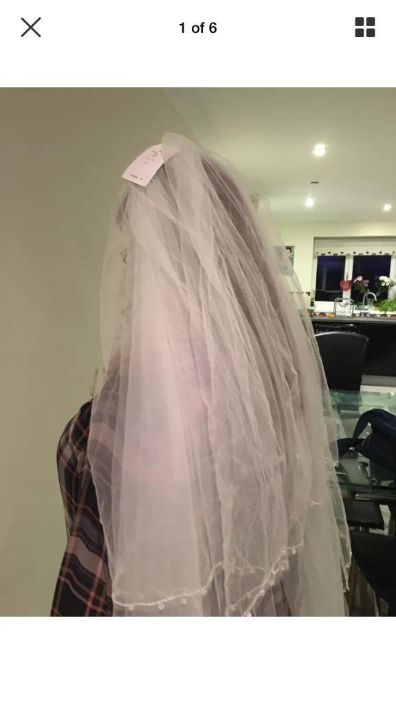 Brand new with tags. Wedding veil by Richards Designs. Cost £65