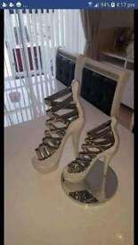 2 beautiful white and silver decorative shoes